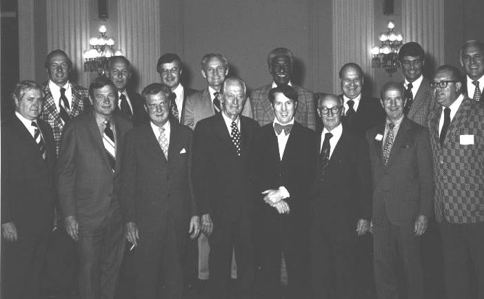 Illinois Congressional Delegation at Illinois State Society Party in their honor on Sept. 22, 1974. Left to right in the bottom row are Congressman Morgan Murphy, Dan Rostenkowski, Harold Collier, Les Arends, Ken Gray, Melvin Price, Bob McClory, and Ed Derwinski. Top row from left are Tom Railsback, Bob Michel, Bob Hanrahan, Sam Young, Ralph Metcalfe, Frank Annunzio, Phil Crane, and George O'Brien.
