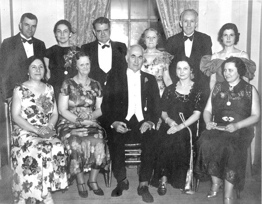 ILSS officers for 1939-1940 pose for a photo before the annual formal dance. At center seated is Society President Reginald W. Frank. Other officers that year, not all identified included Mr. George Stonebraker, Mrs. Grace Cooper, Mr. George H. Cameron, Mr. R.E. Espey, Mrs. W.F. Ferrell, Mr. Howard Law, and Miss Elsie Green.  On August 26, 1939, ISS members took a train to New York to celebrate Illinois Day at the World of Tomorrow World's Fair. A few days after they returned to Washington, World War II began in Europe when Germany invaded Poland.