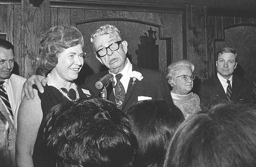 According to the Washington Star for Jan. 20, 1969, more than 1,000 members and guests of the Illinois State Society gathered at the Gramercy Inn for a party to celebrate the Inauguration of President Richard M. Nixon.  Enjoying the party are from left to right, former Illinois State Society President Helen Lewis of Macomb, a board member for more than 50 years, and U.S. Senator Everett M. Dirksen at the podium. Mrs. Luella Dirksen and U.S. Senator Charles H. Percy are in the rear at right.