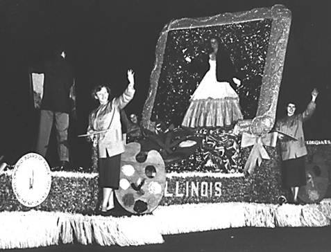 Illinois State Society Float 1954 This Illiniois State Society float was part of a night-time lighted Cherry Blossom Festival parade in the central shopping district on K Street, NW. The cherry blossom princess at the top of the float was Nancy Rainville from Chicago whose father Harold Rainville was the manager for Sen. Everett Dirksen's Chicago office and his top poltical advisor in the state.