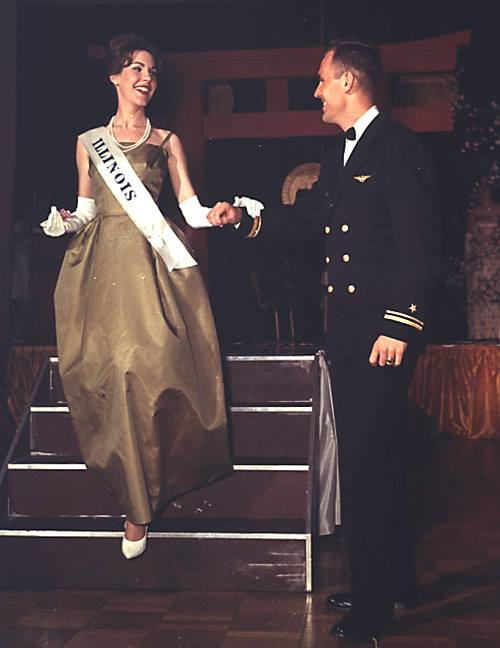 Kate Springer of Springfield, Illinois was the daughter of Congressman and Mrs. William Springer, She was sponsored by the Illinois State Society to represent our state in the 1963 National Cherry Blossom Festival. She is shown at the ball escorted by Navy Lt. John F. Kennedy who by coincidence had the same name as President Kennedy but was no relation to that family from Massachusetts.