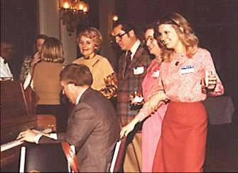 Just like in days of yesteryear, Illinois State Society President Dave Jenkins plays the piano and leads the singing at a 1978 party as Violet Watka and Marve Boruff sing along. The position of song leader was always an important one from the 1920s to the 1960s. One song leader was the 1938 ISS President Frank Sanderson from Pana who was Chief Administrator of the White House for thirty-one years. Another great song leader was 1966 ISS President and Congressman Bob Michel.